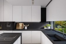 14 a modern space with white kitchens with matte black counters and a backsplash, no handles and additional lights