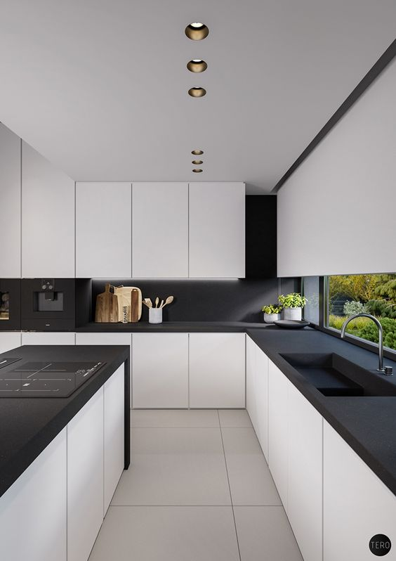 a modern space with white kitchens with matte black counters and a backsplash, no handles and additional lights