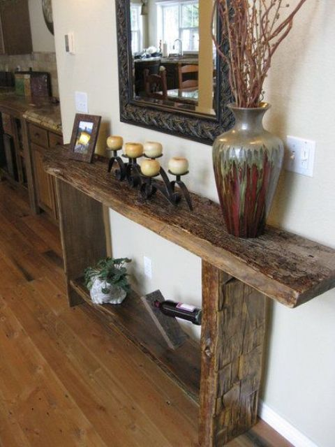 a reclaimed wood console with a wine stand and a large vase brings a rustic feel to the space