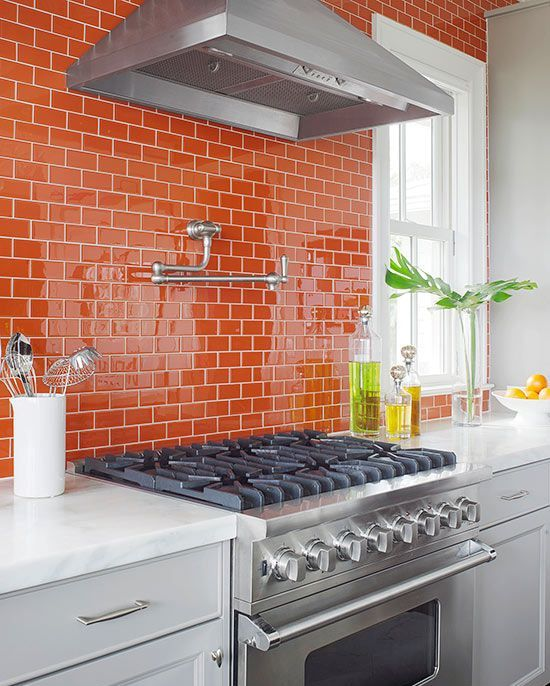 a bold glossy orange tile kitchen backsplash will cheer it up at once