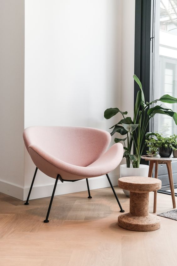 a chic and eye-catchy blush chair is a cool touch for any living room