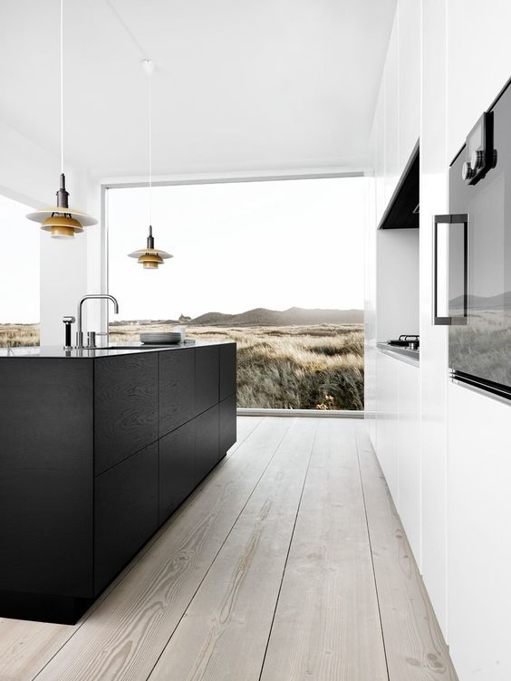 a modern black and white space with a panoramic window, wooden floors and a niche