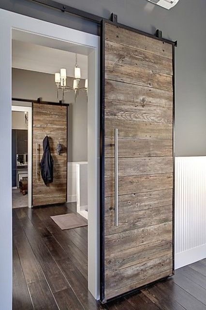 a reclaimed wood sliding wood door looks modern and rustic at the same time