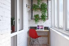 17 an industrial home office with a small desk, a tile floor and whitewashed brick walls