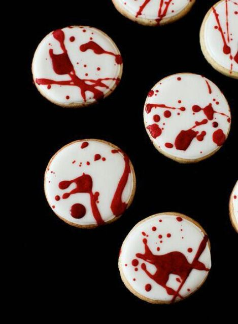 blood splatter cookies are ideal for a dessert table at a vamprire Halloween party