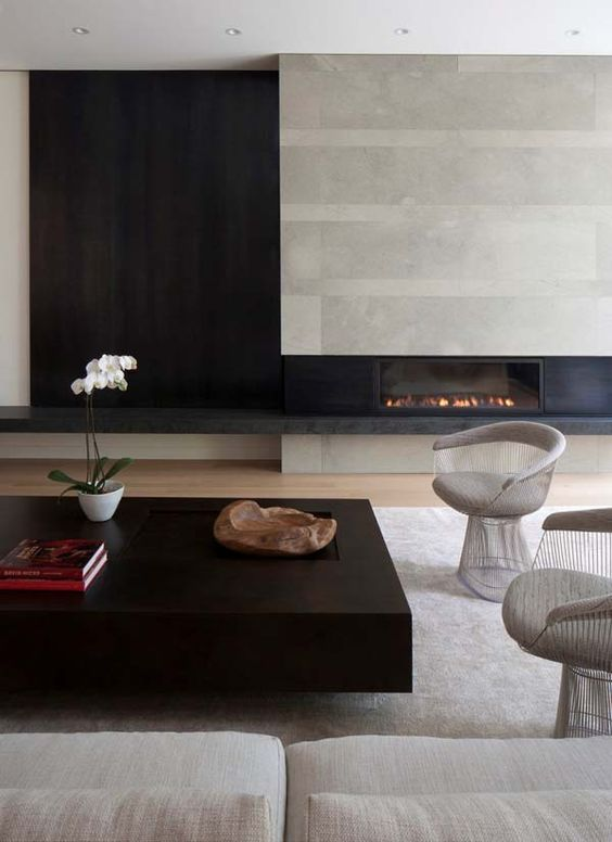 modern aesthetics with concrete, black wood, various textiles and a chic coffee table
