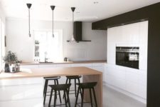 18 a black and white kitchen with wooden counters looks bold and modern