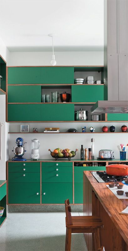 a modern bold green kitchen with copper framing and a grey backsplash looks cute and eye-catchy