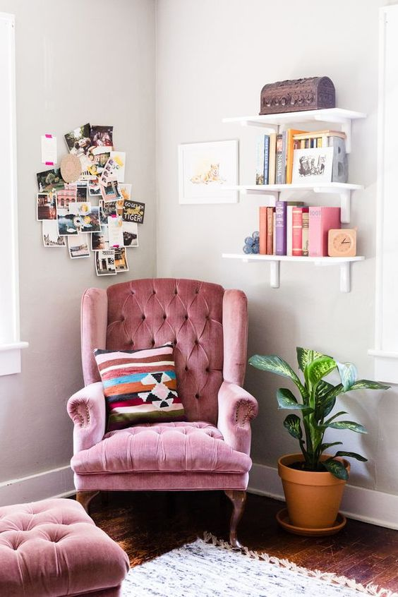 a pink velvet armchair with a footrest can become a nice base for a reading nook