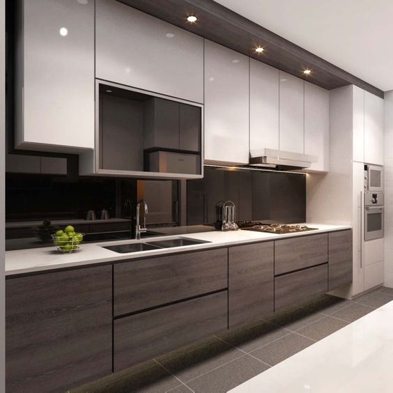 a contrasting kitchen with white and wooden cabinets and a sleek black glass backsplash
