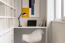 19 a minimalist home office with a large built-in shelving unit and desk