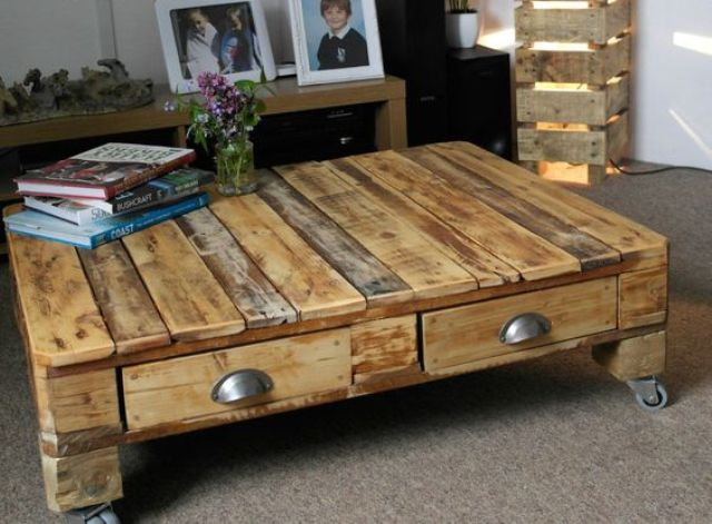 a reclaimed pallet wood low coffee table on casters with drawers can be easily DIYed
