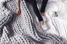 20 a grey chunky knit blanket will add warmth and a textural touch to your bed