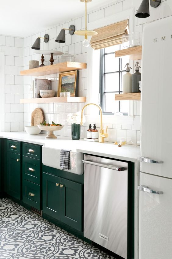 bold emerald cabinets add a colorful touch to this neutral space and contrast the white tiles