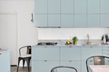 21 a beautiful aqua-colored kitchen with lots of cabinets and whitewashed wooden floors for a light feeling