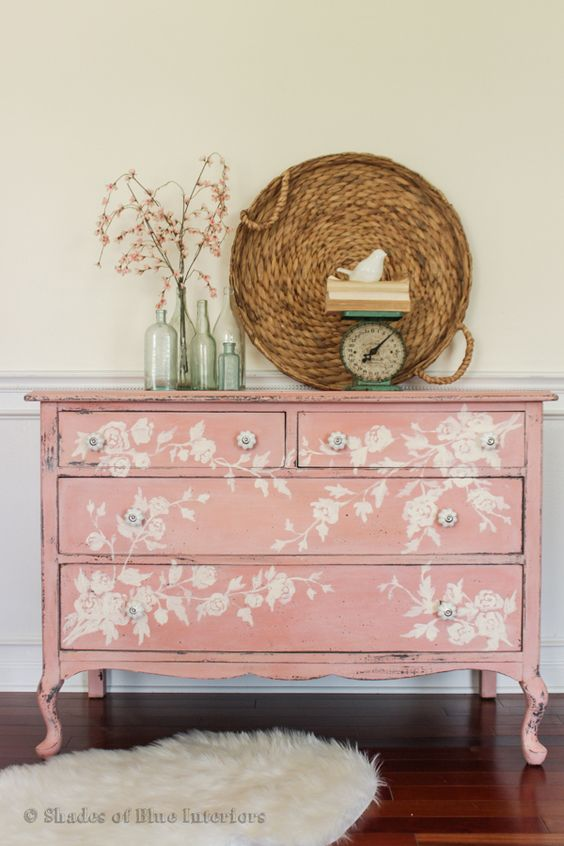 a refined vintage pink sideboard with white floral stencils for a sophisticated touch