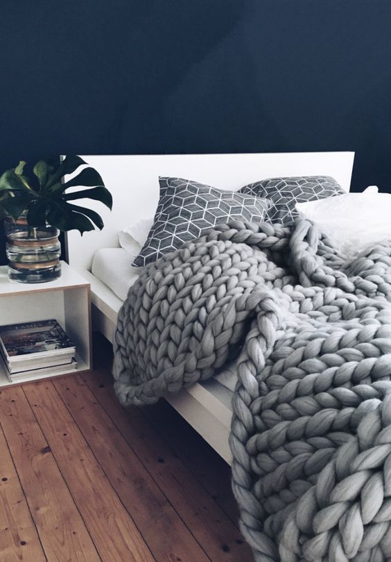 chunky knits are a perfect hygge accessory, they can fit any kind of bedroom