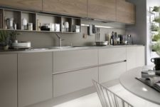 22 a chic grey and wood kitchen looks very eye-catchy and wood adds texture