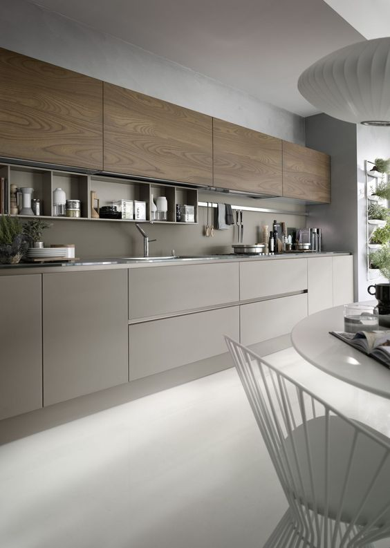 a chic grey and wood kitchen looks very eye-catchy and wood adds texture