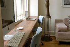 22 a long windowsill is used as a double workspace