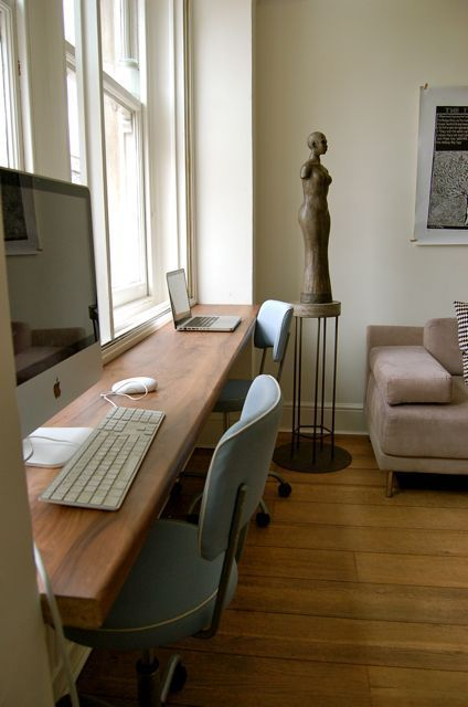 a long windowsill is used as a double workspace