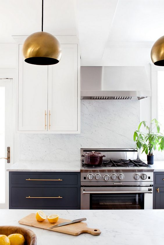 bold copepr lamps and handles take over the stainless steel cooker and hood