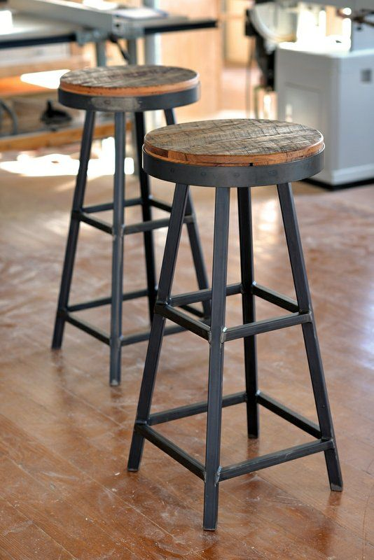 reclaimed wood stools with black metal framing add both a rustic and an industrial feel