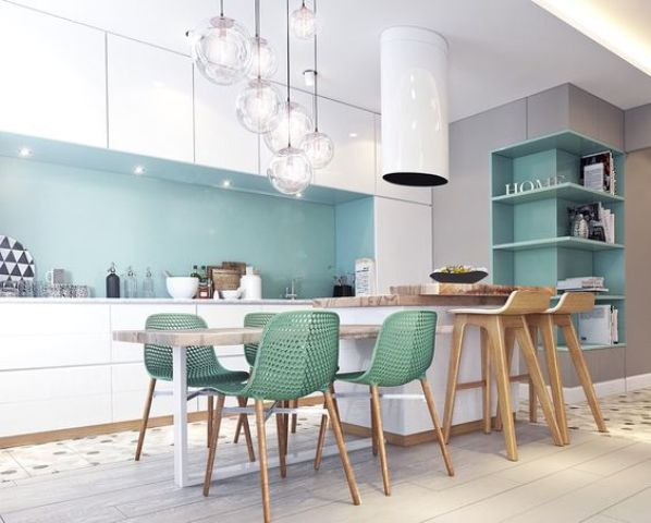 a chic kitchen with white cabinets and blue backsplash, green chairs and eye-catchy bubble pendant lamps