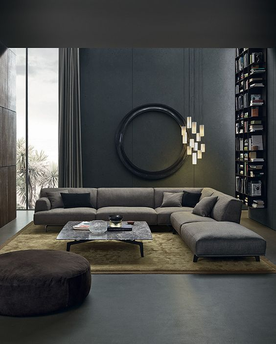 a moody living space with dark walls, cool lights cluster and comfy textural textiles