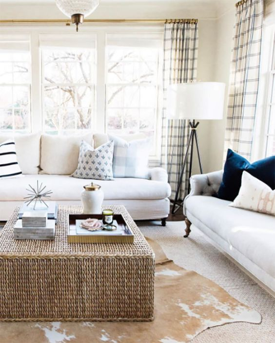 a wicker coffee table and a faux animal skin rug for a cozy feel