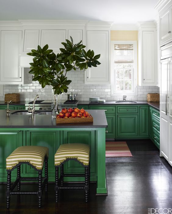 bright green cabinets and a kitchen island are balanced with white cabinets and a backsplash