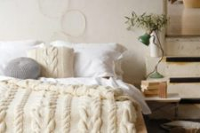 24 chunky cable knit pillow, bedspread and an ottoman for the coziest bedroom look and feel