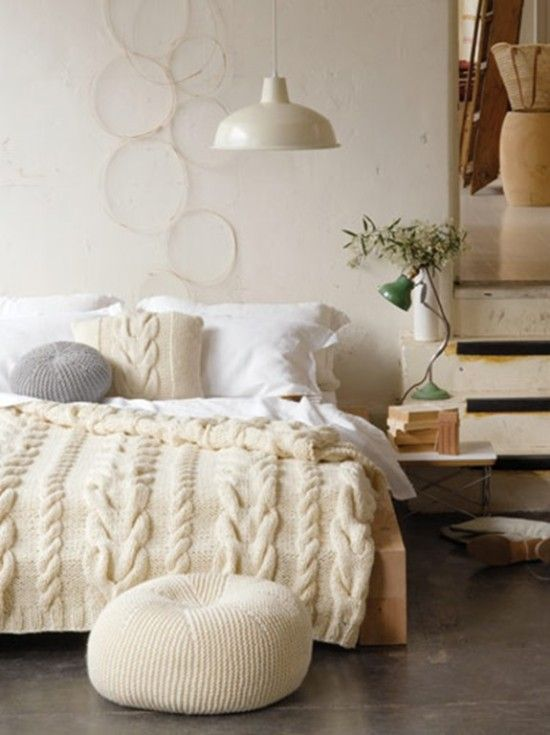 chunky cable knit pillow, bedspread and an ottoman for the coziest bedroom look and feel