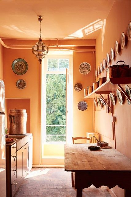 orange walls are a nice idea to make a traditional kitchen non boring