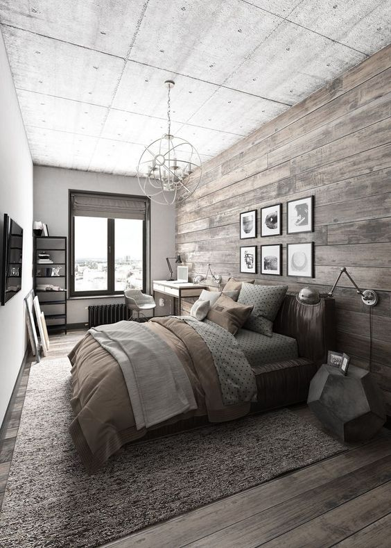 a bedroom with a wall and floor of reclaimed wood to feel cozier here