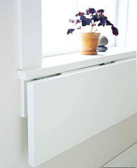 a folding windowsill can be used as a desk or a dining space