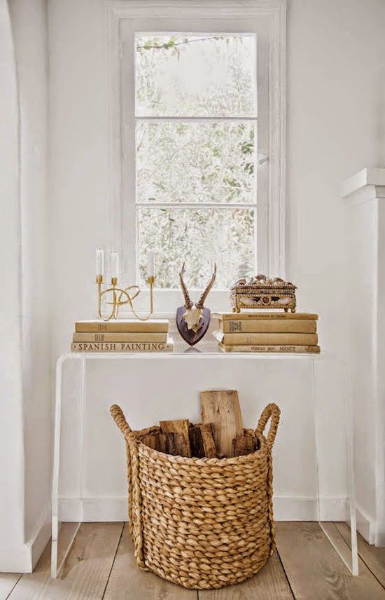 a wicker basket with firewood is a nice way to add a cool rustic feel to the space