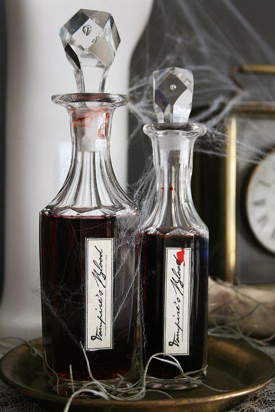 gorgeous idea for Halloween - pour some red wine into elegant bottles