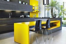 26 a modern colorful kitchewn with dark grey and neon yellow touches looks bold