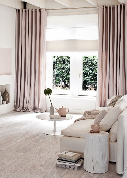 a modern neutral living space with dusty pink curtains to add a pastel touch
