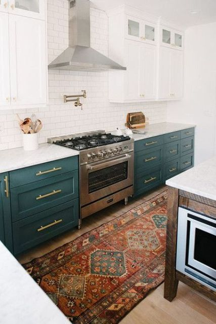 dark green cabinets contrast white cabinets and tiles and create a chic vintage-inspired kitchen