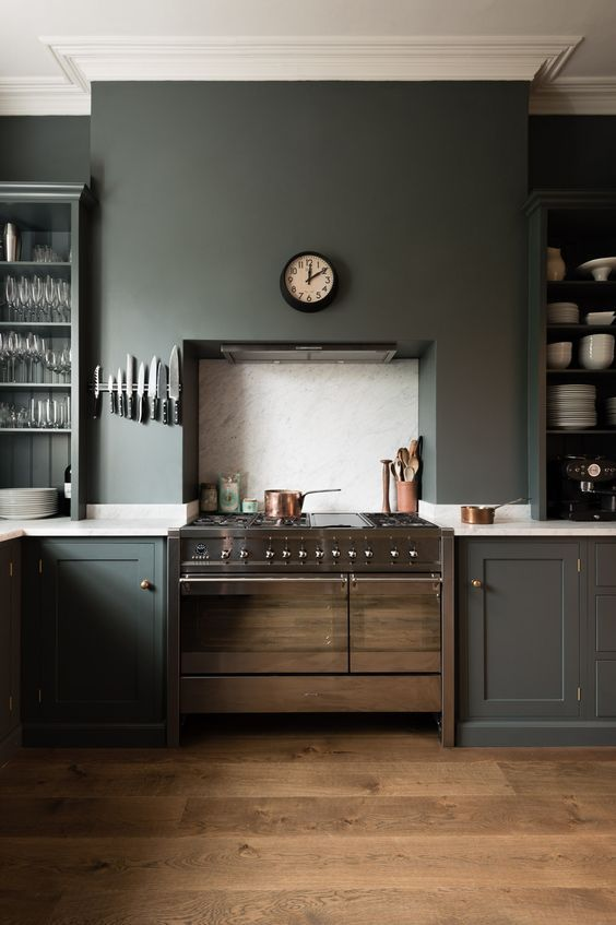 graphite grey kitchen with white countertops, metallic touches is a nice idea for a concept of a moody space