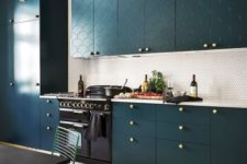 29 a teal kitchen with patterns, a penny tile backsplash and brass touches for a refined touch