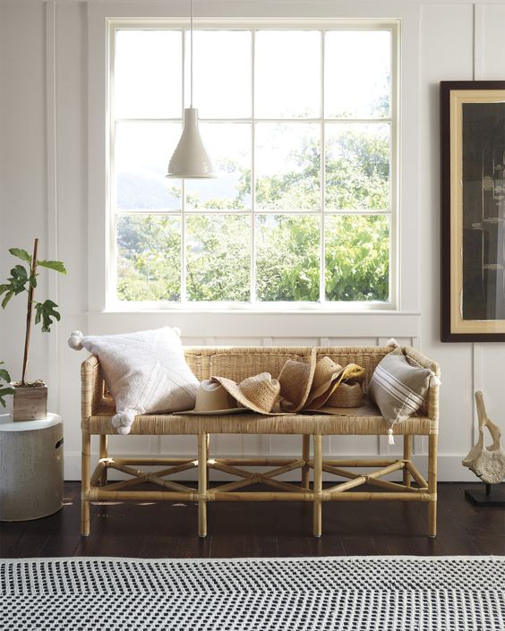 a wicker bench is a gorgeous idea for an entryway and it brings a cozy feel
