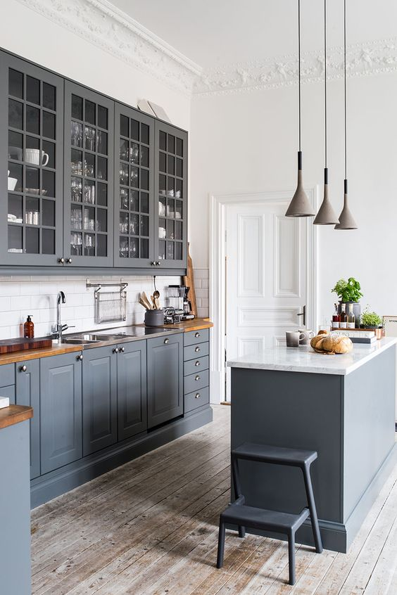 vintage graphite grey kitchen with whitewashed wooden floors, wooden countertops and white walls to make it look fresher