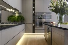 32 a stylish grey kitchen with lighting up, a vertical open shelf and a large kitchen island