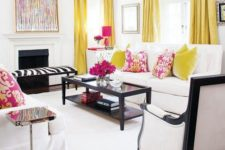 a chic and bold white space is made more colorful with yellow and fuchsia, and black highlights the decor