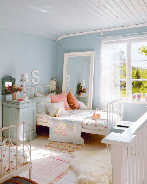 serenity blue is an ideal main color for a kids' room, soft pinks are additional, and white color polishes it all