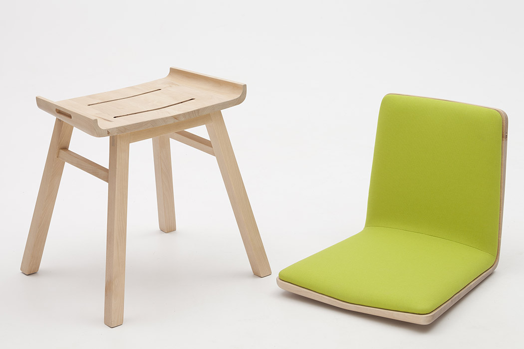 Dividi chair is a modern piece that features two seats, it's done in light colored wood and neon yellow upholstery for a bold modern look