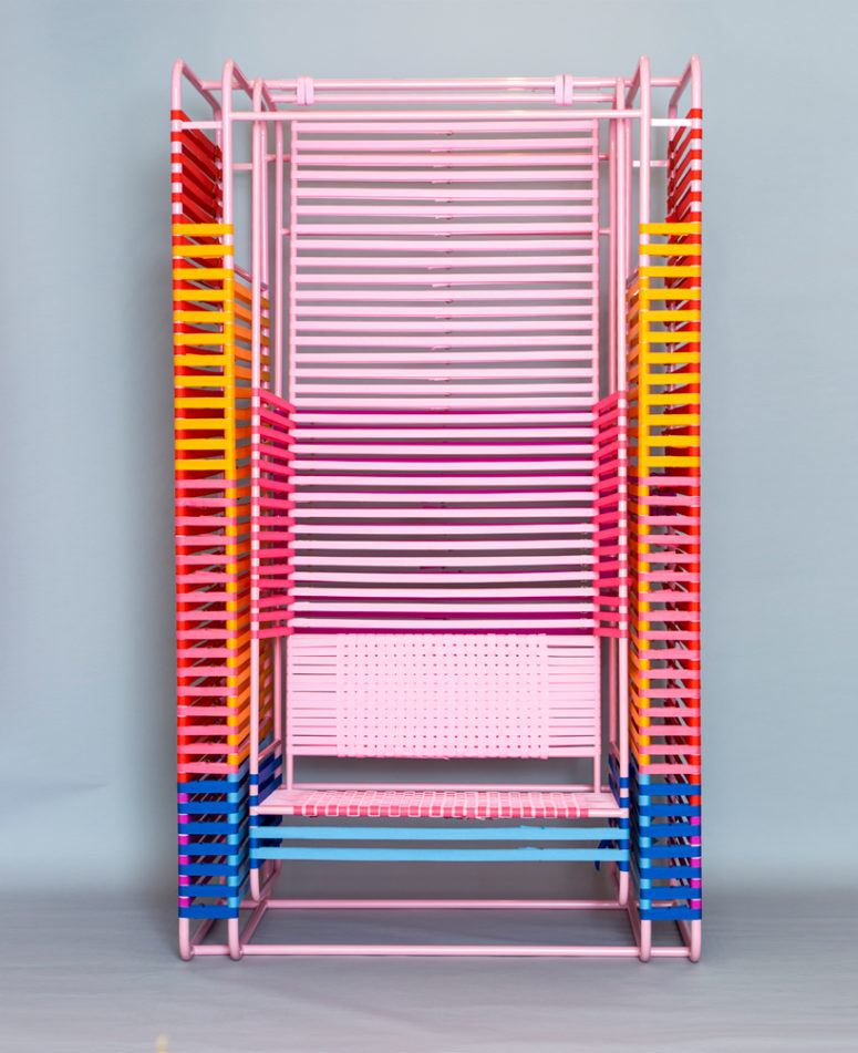 Iris is a swinging chair made of metal painted pink and 600 of nylon bands, that all gives it a crazy look